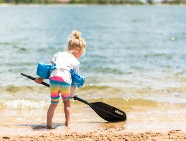 pikes-peak-outdoors-activities-suping-kid-with-paddle